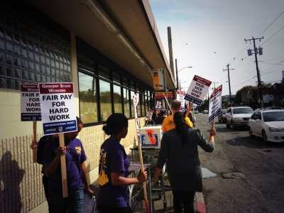 Grocery workers picket Wednesday on 15th Ave E
