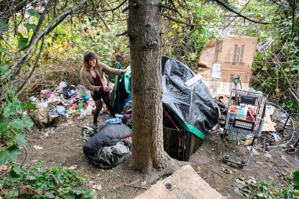 Ashley worked hard to clear out the garbage which included condoms, gallon water jugs filled with urine, bike parts and lots of trash. She had even devised a sifter made from a shopping basket to sift out the 'dirty points' (used needles) from under her tent. (Image: Tim Durkan)