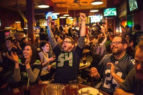 Fans celebrating earlier this season at the now closed-for-construction Bill's On Broadway (Image: Nate Cleese for CHS)