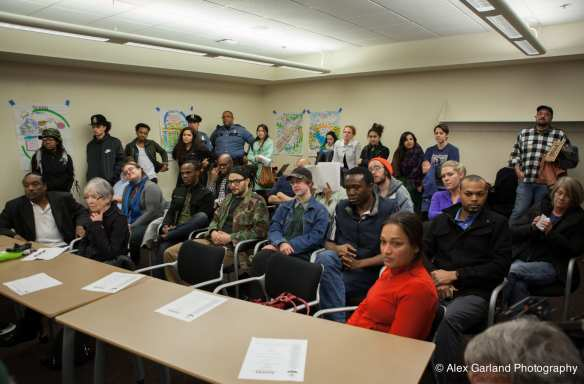 Meet your community, Capt. Davis -- the crowd at last week's meeting on Waid's. Owner Waid Sainvil, second from the left in the front, told CHS he believes his club has been targeted because it attracts a largely black clientele.