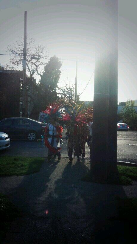 The Native American dancers from today's march make their way back up the Hill (Image: Jacob Olson)