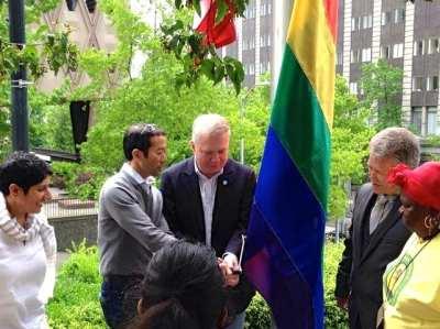 Mayor Ed Murray and his husband Michael Shiosaki help raise the Pride flag at City Hall (Image: City of Seattle)