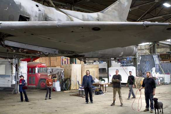 Mike Ross and crew in 2010 after after receiving the A14 fighter jet for the future installation in Capitol Hill Station (Image: Kat Nyberg Photography with permission to CHS)