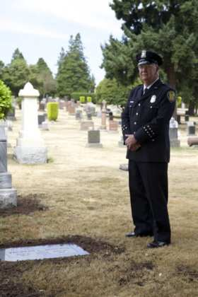 Severance stands by the new Lake View gravestone for Officer Thomas Roberts, who died in the line of duty in 1898 (Image: SPD)