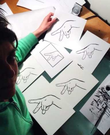 """Here's a photo of me re-drawing the ""Walking Fingers"" design for the West Entry,"" Forney writes. (Image: Ellen Forney with permission to CHS)"