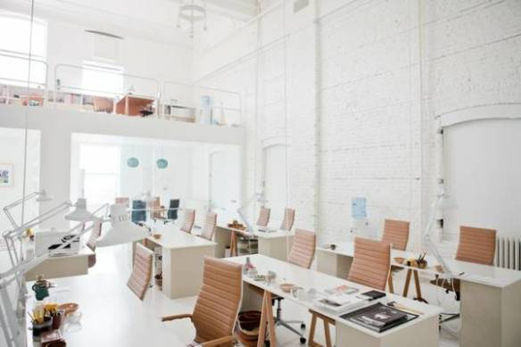 """""""I work best in clean, calm, and vibrant spaces—spaces where you stay energized but maintain focus,"""" Wenger told Remodelista. """"I like white because it's bright and reflects natural light through a room. Painting desks and objects white eliminates visual blocks, so that heaviness just disappears."""" (Image: Remodelista)"""