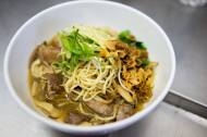 Aromatic duck noodle soup with fried shallots, mustard greens, shiitake, and dates