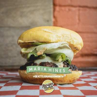 """The Golden Beetle Burger -- """"harissa aioli, lettuce, pickled serranos & onion, gruyere swiss, baharat seasoned 1/3 pound northwest grass fed beef, and mayonnaise with Sumac dusted fries"""""""