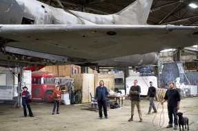 Mike Ross and crew in 2010 after after receiving the A4 fighter jet for the future installation in Capitol Hill Station (Image: Kat Nyberg Photography with permission to CHS)