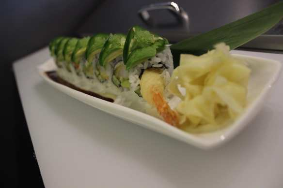 The Green Lake Monster with tempura jumbo shrimp and bamboo leaves has a special plating technique (Image: Agazit Afeworki)
