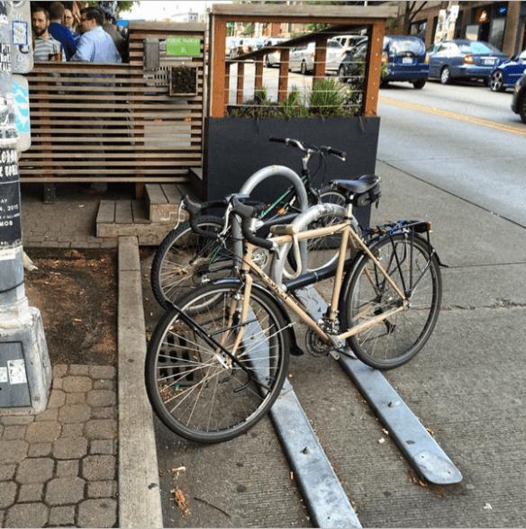 """Thanks to simple bolts, @UrbanRacks A racks are easily stolen. #infrafail"" (Image: @seawonkery via Instagram)"