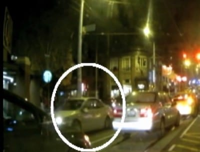 A still from video obtained by local TV stations  shows the graphic moment shots rang out and appears to have captured images of the assailant's vehicle heading south on Broadway
