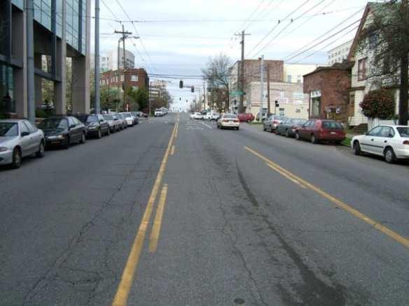 A scene of Broadway with suicide lane, no streetcar tracks, no bikeway. (Photo by Rob Ketcherside)