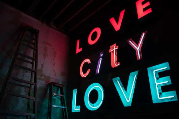 The Love City Love neon sign shines out towards Pike Street at the new location, Tuesday Feb. 2nd, 2016. Lovecitylove's new location at 1406 E Pike St is set to celebrate its grand opening with the return of Open Mic Wednesdays this Wednesday, March 9th and will be open for studio and event use.