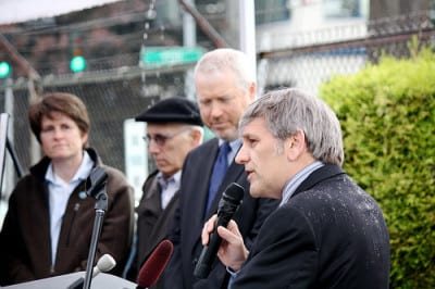Persons at the rainy 2011 announcement of the 12th Ave Arts development agreement with the city (Image: CHS)