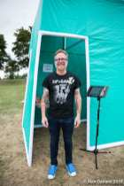 """VOCAL Washington's Greg Scott at a Cal Anderson """"pop-up"""" safe consumption site last summer demonstrating how a facility in Seattle would work -- and providing an opportunity for visitors to leave their thoughts on the project"""