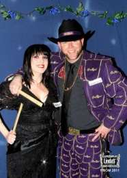 Linda's bartender Christy Elliott with Mike Leifur, wearing a handmade suit fashioned from 140 Crown Royal bags, contents of which were consumed at Linda's throughout 2004 (Photo: Linda Derschang)