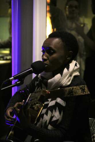 Musican Naomi Wachira performs at Reverb's open house.