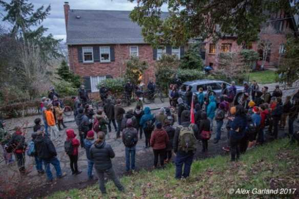 Protesters said they were targeting the home of the family member who heads the Midtown Center partnership as Madrona got an unusual influx of activists Saturday night