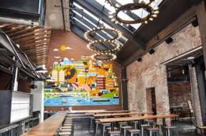 """A focal point inside the brewpub is a custom mural by Grammy-nominated Seattle illustrator and Sub Pop Records Art Director Sasha Barr. The prominent mural on the wall near the front bar is a colorful collage celebrating the city, people, beer, architecture, and the neighborhood."" (Images: R