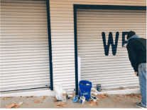 The walk-up's roll-down door was getting a new paint job this week (Image: Monica Dimas)