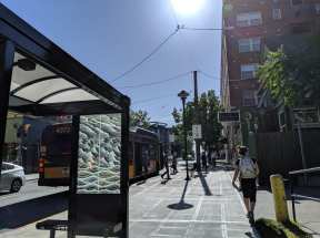 You'll now find new bus shelters and a wide sidewalk along E John -- but no mystery soda machine (Image: @dongho_chang)