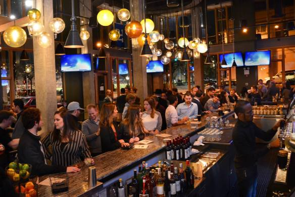 A crowded bar at Stout