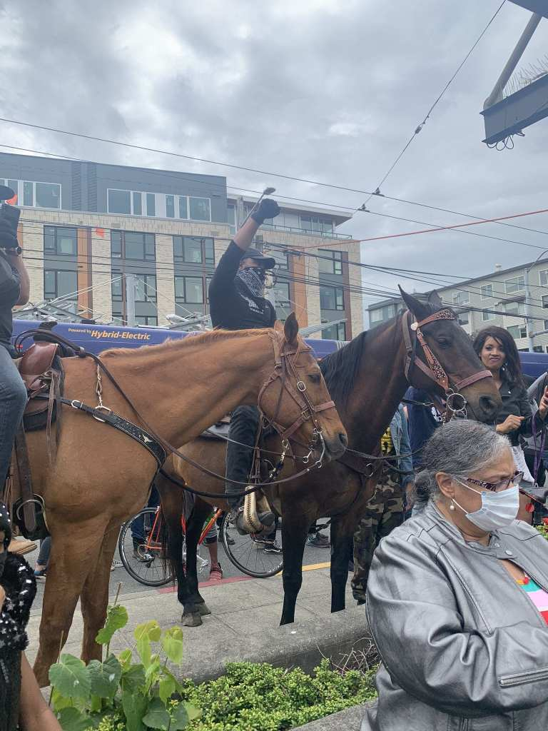 Horse mounted protesters were part of the scene in the Central District