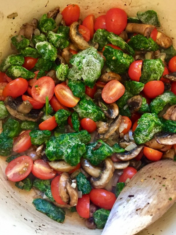 3. Add everything else: spinach, tomatoes, vegetable stock, chives, parsley, cream and mix them. 4. Cover it with a lid and on medium heat, bring it to boil.