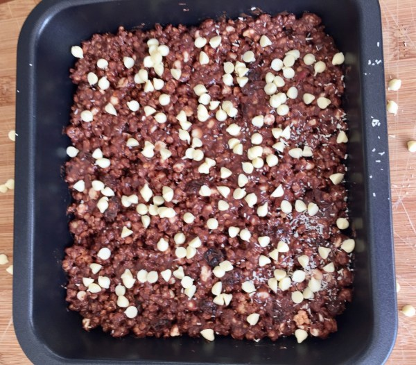 4. Put the mixture into a square shaped baking pan. Cover the whole surface evenly and press it down well. It really need to stick together, so that it won't break easily into crumbles.