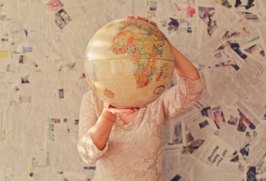 woman travel globe