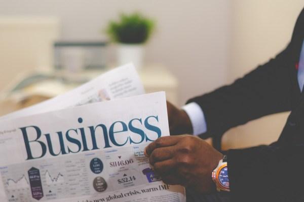 business man newspaper
