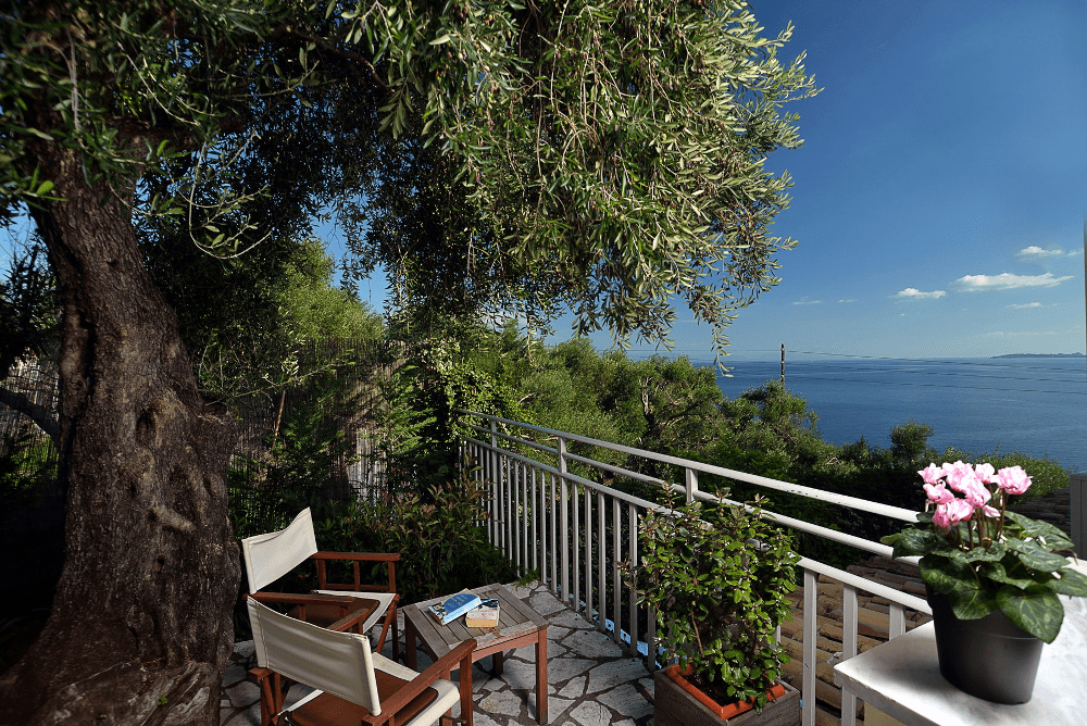 Captain's apartments hotel in Barbati Enjoy the view of Barbati bay from our terrace!
