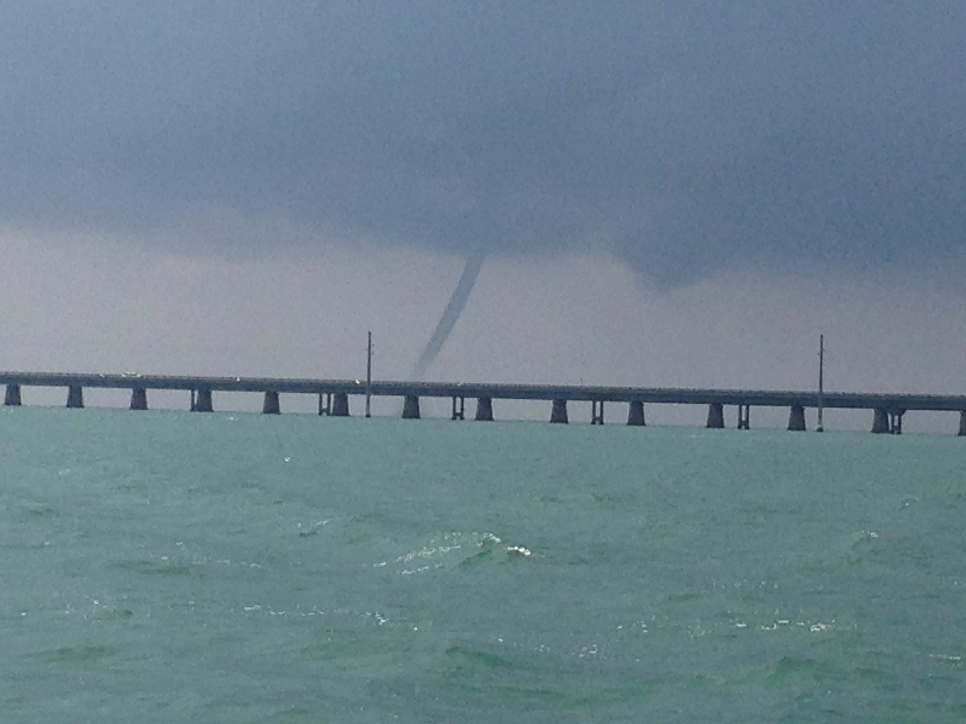 This time of year the afternoons often bring storms. We saw this big water spout on a tarpon charter Tuesday.