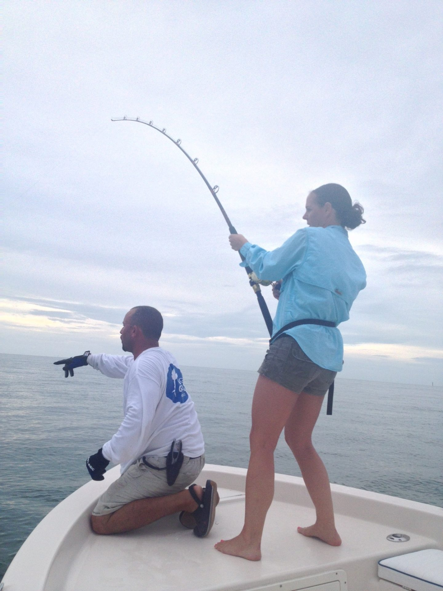 Britta battles a large tarpon off Marathon in the Fl Keys.