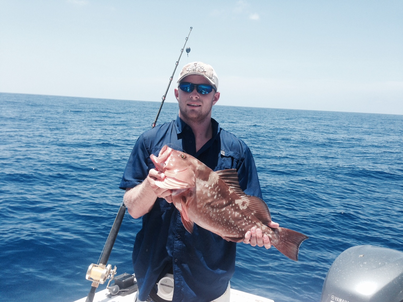 Logan caught this red grouper on a full day fishing charter off Marathon in the Fl Keys