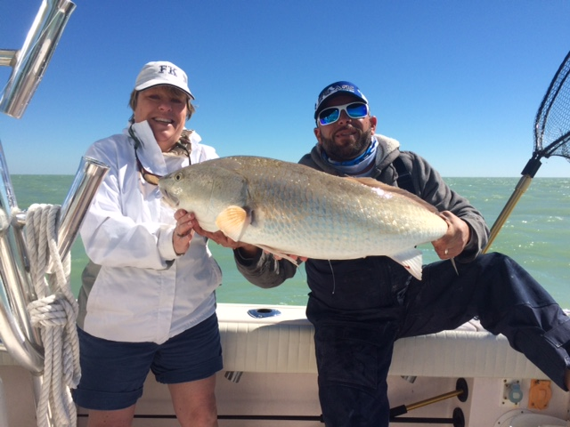 Monster redfish caught on a fishing charter in the bay off Marathon with Capt. Doug.