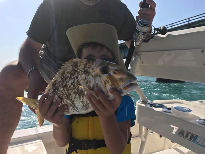 Porgy for my little French buddy. Take your kid fishing with Capt Doug!