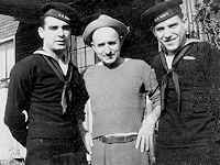 Yogi with brother John and proud father in 1945 (Photo: yogiberra.com)