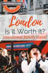 Image of street performer in London on busy street wih text overlay London, I s it worth it? Intentional family travel