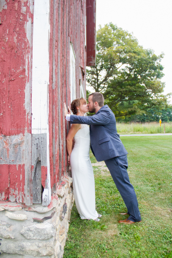 bride groom kiss portrait barn, LeRoy Oakes St Charles