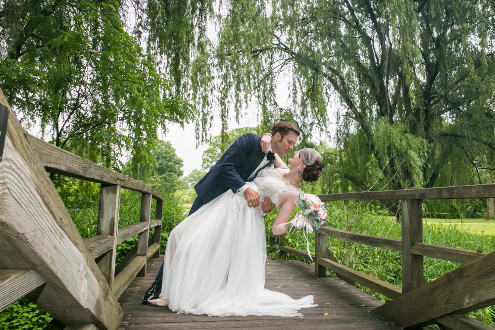 Morton Arboretum Wedding, Bride Groom portrait bend kiss