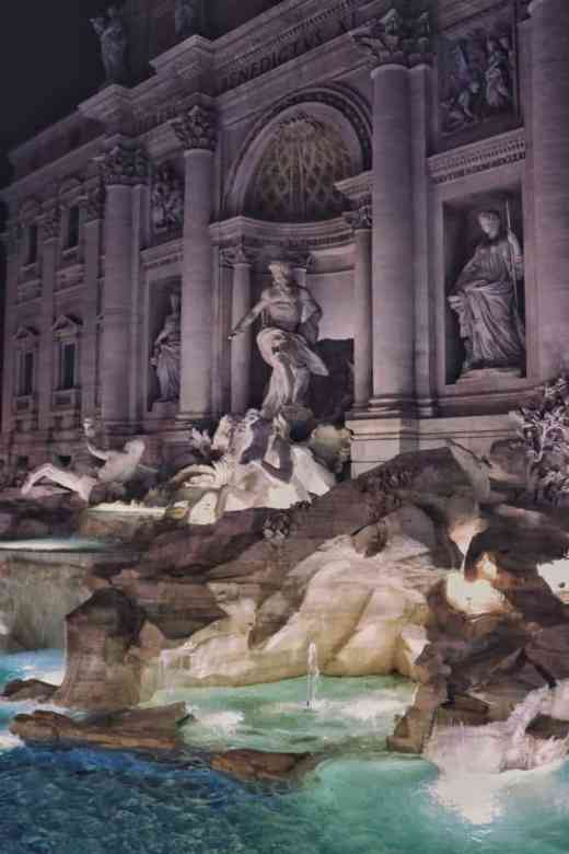 Trevi fountain at night with lit statues