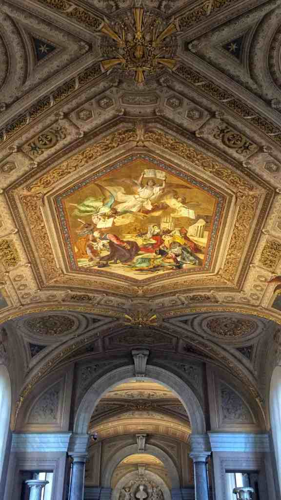 Ceiling painted with angels inside the vatican museum