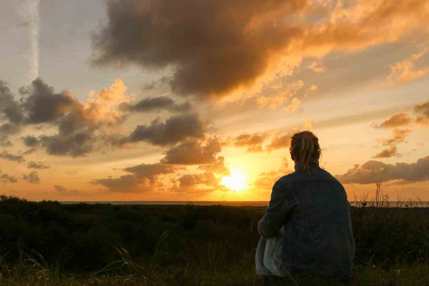 Girl watching the sunset on Schiermonnikoog