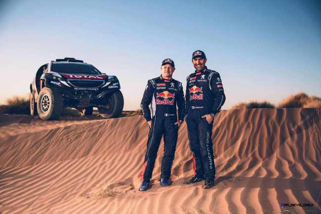 Jean-Paul Cottret and Stephane Peterhansel pose for a portrait during the Peugeot test in Erfoud, Morocco, on June 16th, 2015