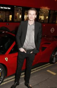 Jamie Campbell Bower in front of Ferrari at the UK launch of the Ferrari 488 Spider at the Watches of Switzerland store, London