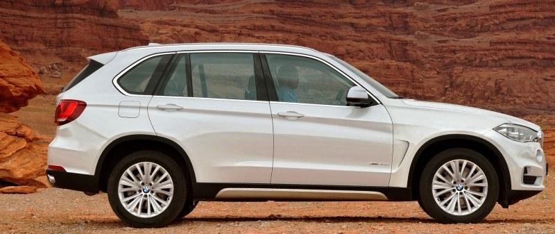 Car-Revs-Daily.com Digital Rendering of 2015 BMW X7 beside 2014 BMW X5 1