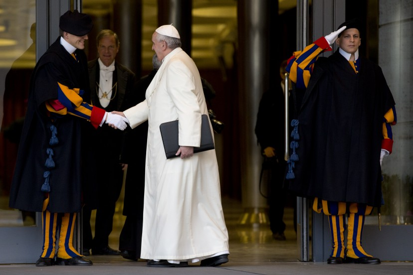 The Pope shakes hands with the Swiss Guard