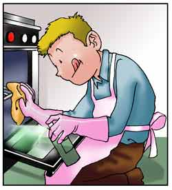 Un uomo sta pulendo il forno della cucina.
